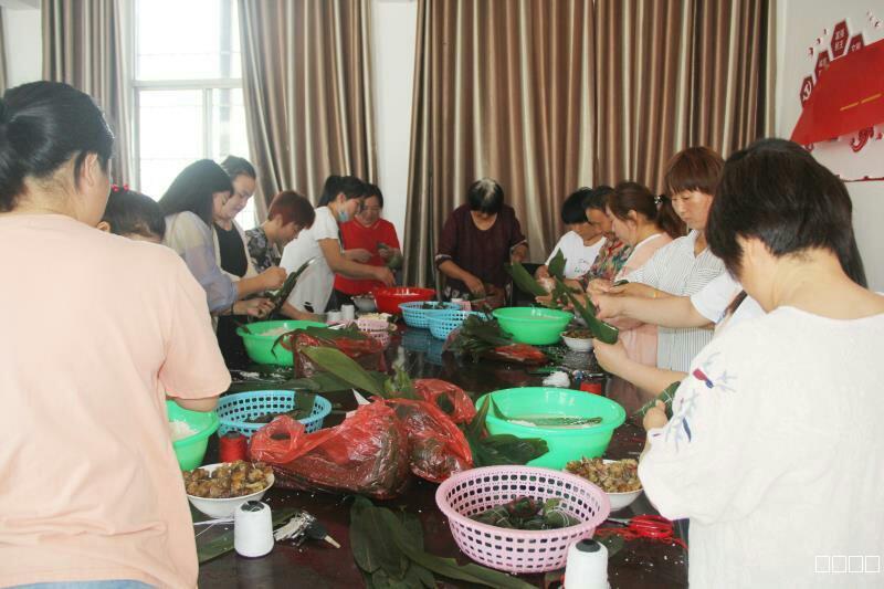 """九龙镇新时代文明实践所开展系列活动——""""我们的节日·端午节""""包粽子比赛"""